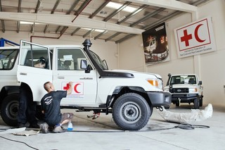 Land Rovers being prepped for the field in the IFRC garage in Dubai.  Pieter van den Boogert for The Correspondent