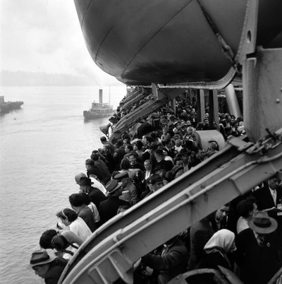 Boat with displaced persons from World War II arriving at Ellis Island. Photo by Getty