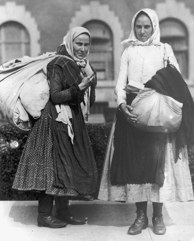 Two young Polish peasant women ready to leave Ellis Island, c. 1910. Photo by Getty